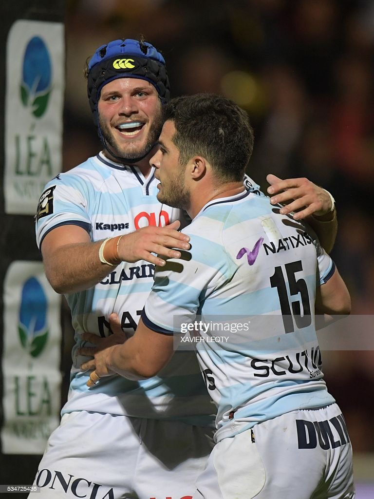 Racing 92's French flanker Luc Barba (L) celebrates with teammate Brice Dulin (R) during the French Top 14 rugby union match La Rochelle vs Racing 92 on May 27, 2016 at the Marcel Deflandre stadium in La Rochelle, southwestern France.