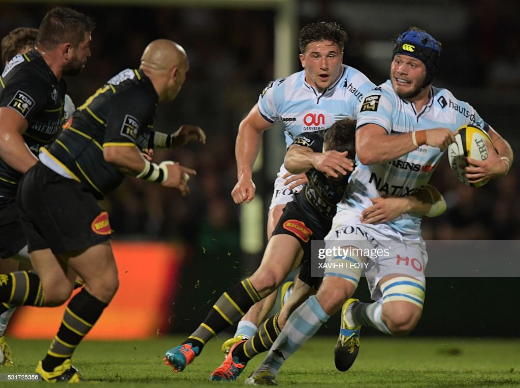 Racing 92's French flanker Luc Barba runs with the ball during the French Top 14 rugby union match La Rochelle vs Racing 92 on May 27, 2016 at the Marcel Deflandre stadium in La Rochelle, southwestern France.