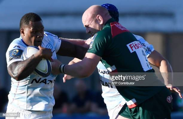 Racing 92's New Zealander center Virimi Vakatawa vies with Leicester's British prop Dan Cole during the Champions cup rugby union match between...