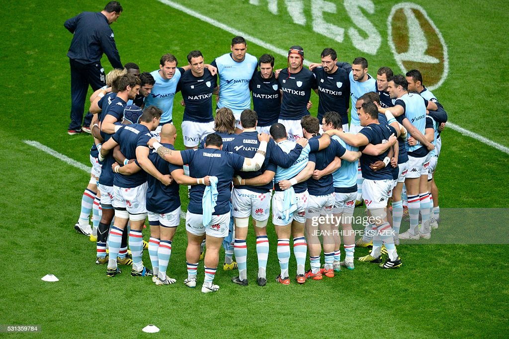 Racing 92's players stand together ahead of the European Rugby Champions Cup match beetween Racing Metro 92 and Saracens FC at the Parc Olympique...