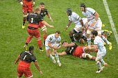 Racing 92's players vie with Saracens' players during the European Rugby Champions Cup match beetween Racing Metro 92 and Saracens FC at the Parc...