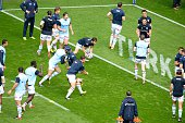 Racing 92's players warm up ahead of the European Rugby Champions Cup match beetween Racing Metro 92 and Saracens FC at the Parc Olympique Lyonnais...