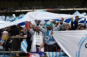 Racing 92's supporters cheer for their team ahead of the European Rugby Champions Cup match beetween Racing Metro 92 and Saracens FC at the Parc...