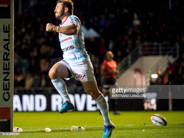 Racing 92's winger Marc Andreu celebrates after scoring a try during the French Top 14 rugby union match between RC Toulon and Racing 92 on November...