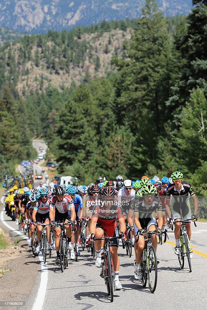 Racing and Cannondale Pro Cycling lead the peloton on the climb of Devil's Gulch during stage six of the 2013 USA Pro Challenge from Loveland to Fort Collins on August 24, 2013 in Glen Haven, Colorado.