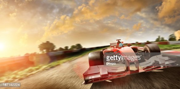 Racing Car At Speed In Summer Sunset