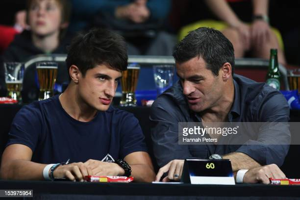 Racing car driver Mitch Evans talks with All Whites captain Ryan Nelsen during the round two NBL match between the New Zealand Breakers and the...
