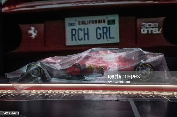 A racing car is seen under a covering foil as preparations are under way for the Internationale Automobil Ausstellung auto show on September 11 2017...