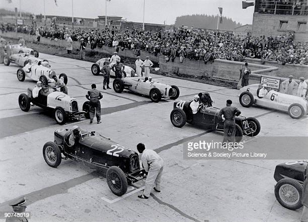 Racing cars being prepared on the starting grid at the Nurburgring racetrack Photograph by Zoltan Glass