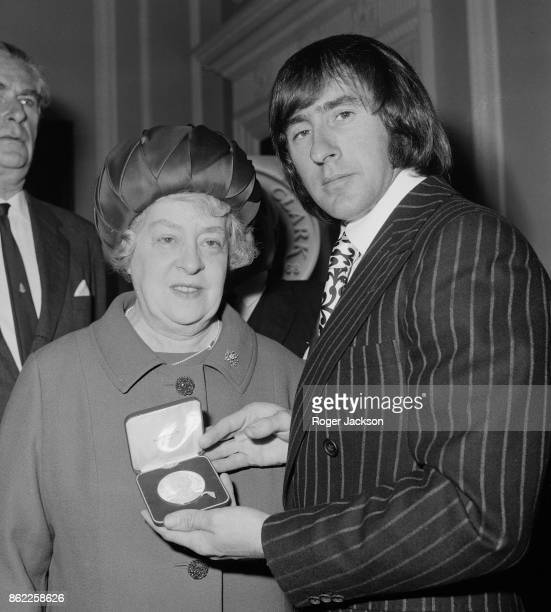 Racing champion Jackie Stewart presents Mrs James Clark with the first medal commemorating her son racing driver Jim Clark at the RAC in London 23rd...