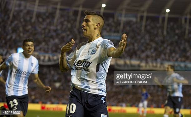 Racing Club's midfielder Ricardo Centurion celebrates after scoring a goal against Godoy Cruz during their Argentine First Division football match at...