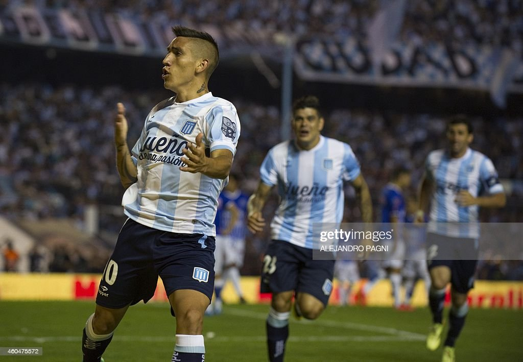 Racing Club's midfielder Ricardo Centurion (L) celebrates after scoring a goal against Godoy Cruz during their Argentine First Division football match, at Presidente Juan Domingo Peron stadium in Buenos Aires, Argentina, on December 14, 2014. AFP PHOTO / Alejandro PAGNI