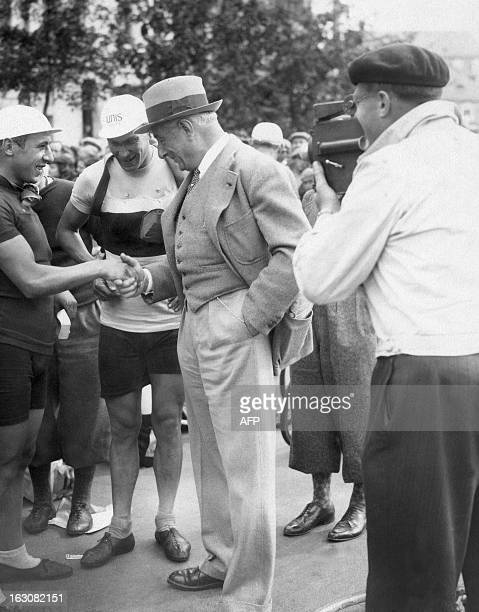 Racing cyclist Arsene Mersch of Luxembourg and French Yvan Marie greet Farouk before the start of the 4th stage MetzBelfort of the Tour de France on...