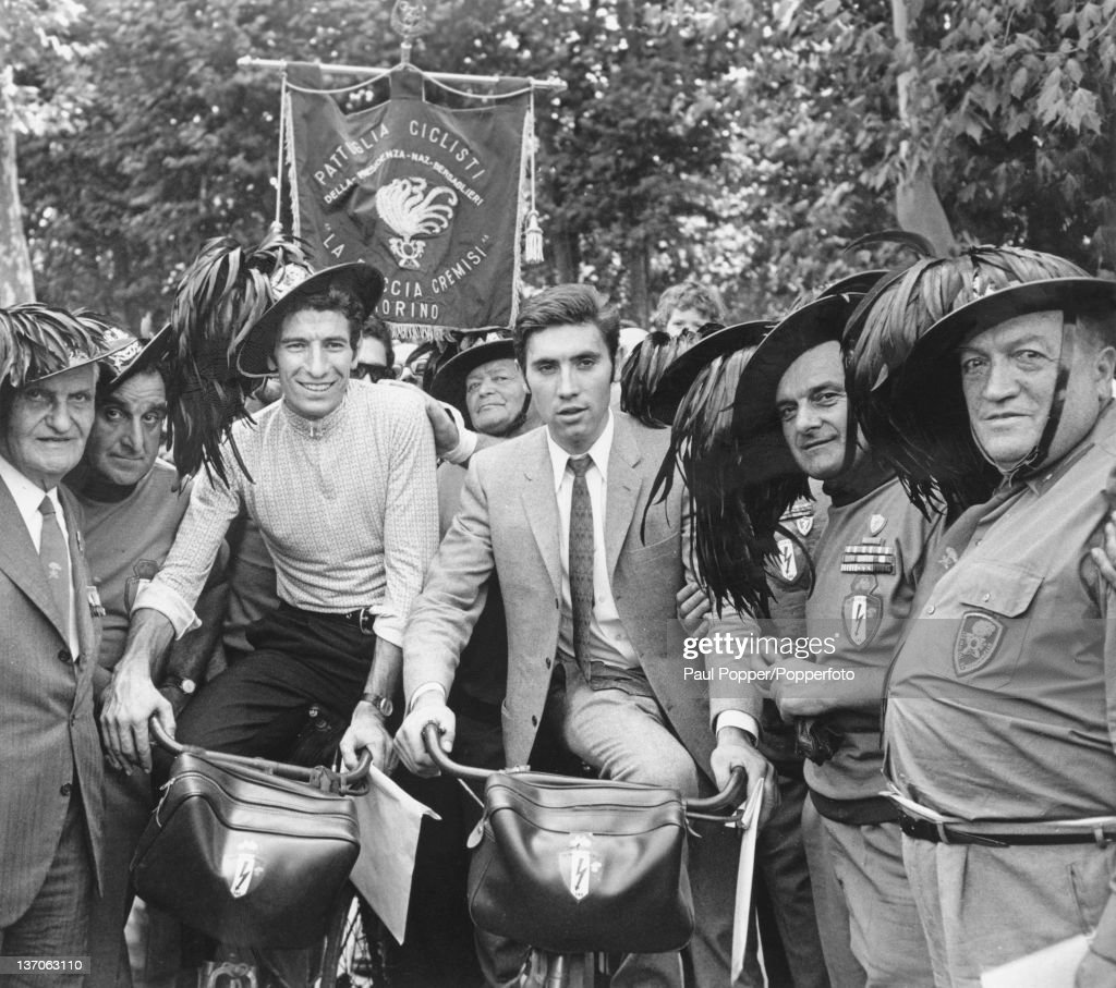 Racing cyclists Felice Gimondi of Italy (left) and <a gi-track='captionPersonalityLinkClicked' href=/galleries/search?phrase=Eddy+Merckx&family=editorial&specificpeople=213957 ng-click='$event.stopPropagation()'>Eddy Merckx</a> of Belgium (centre), with members of the Italian Bersaglieri corps, during celebrations of the centenary of the Italian capital, Rome, 19th September 1970.