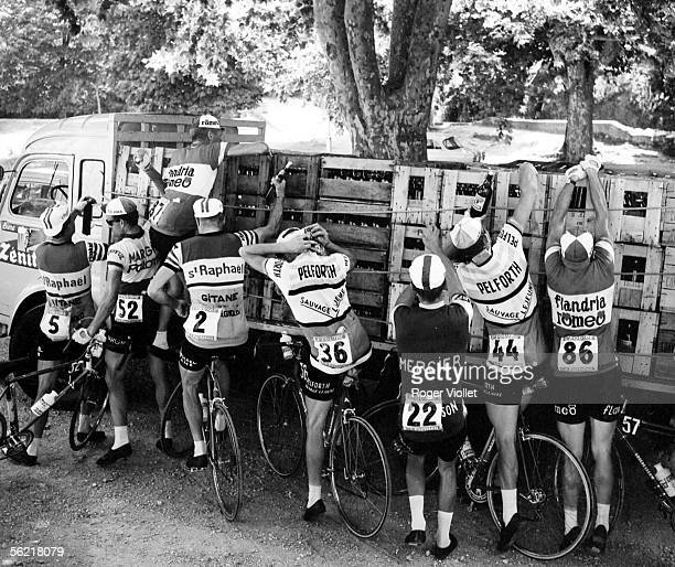Racing cyclists getting fresh supplies in the during the 11th stage of the Tour de France between Toulon and Montpelier 2nd July 1964 From left to...