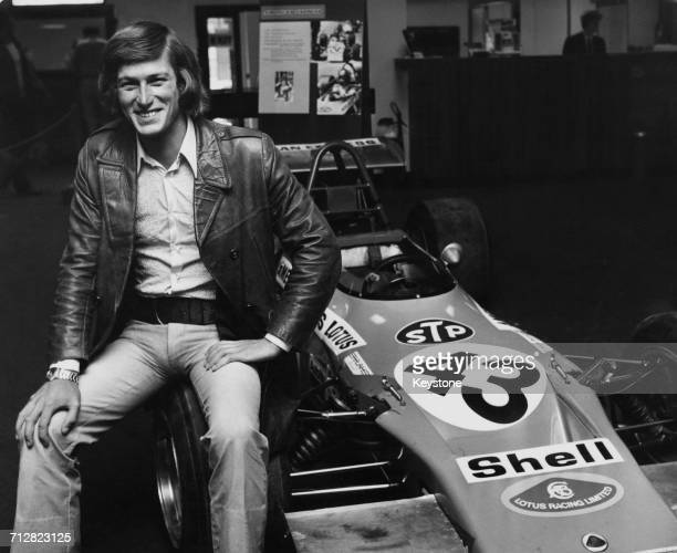 Racing driver Andy Sutcliffe poses for a portrait beside his Lotus 69 Ford/Holbay Formula Three racing car at the headquarters for American Express...
