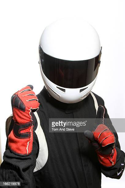 Racing driver celebrates winning