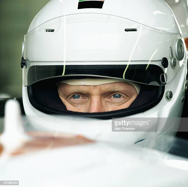 Racing driver in car, close-up