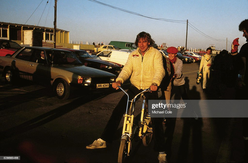 Racing Driver James Hunt on bicycle relaxing at home in Spain Feb 1979