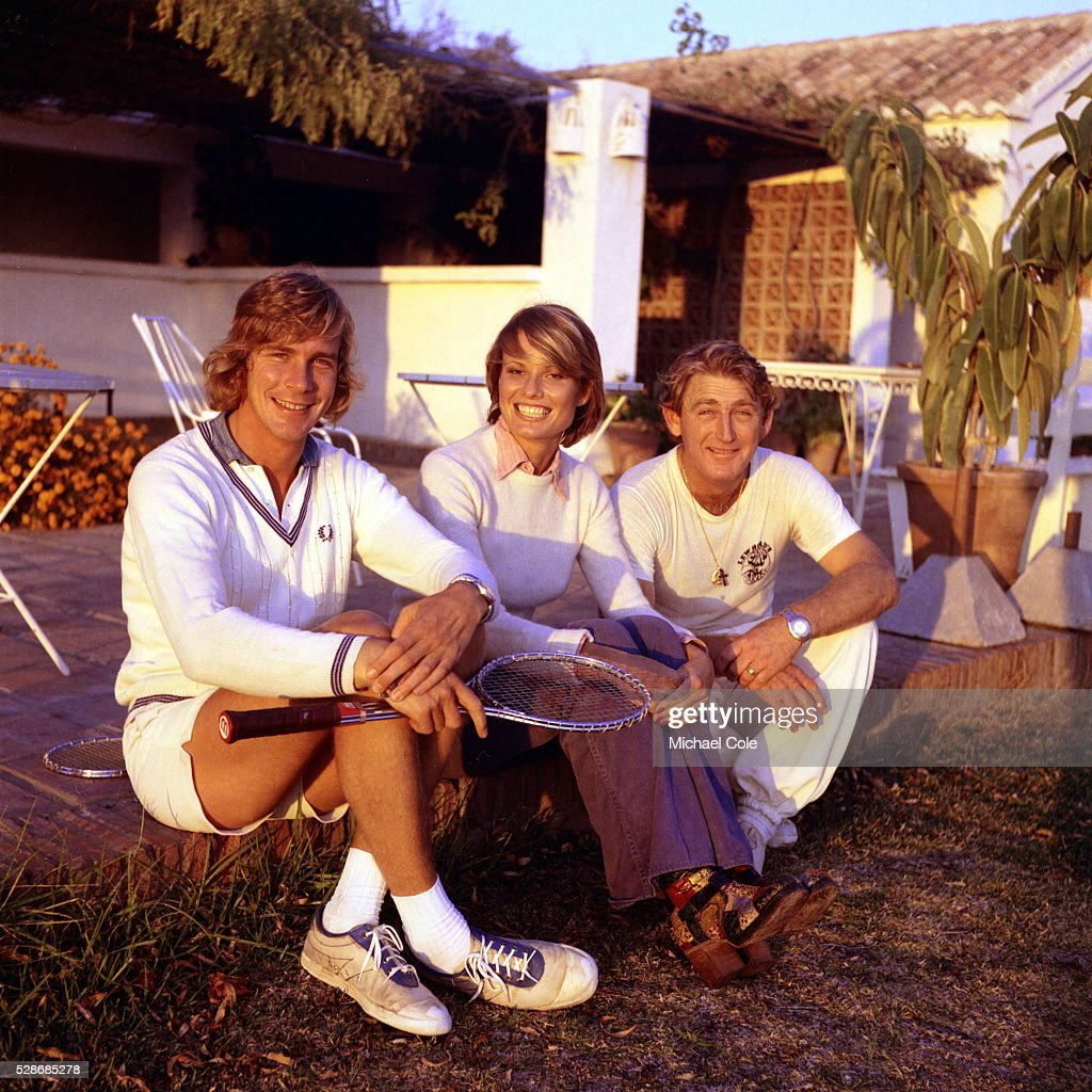Racing Driver James Hunt wife Suzy with Lew Hoad at Lew Hoad's 'Campo De Tenis' in Mijas Spain December 1974