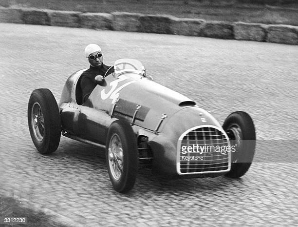 Racing driver Juan Manuel Fangio of Argentina in action in a Ferrari at Monza Italy