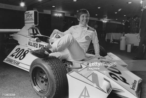 Racing driver Lella Lombardi of Italy poses for a portrait beside her Allied Polymer Group Brabham BT42 Ford Cosworth DFV racing car during a...