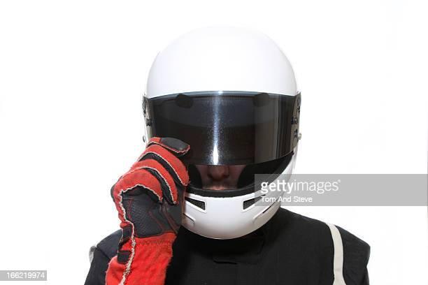Racing driver lifts open helmet visor