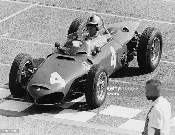 Racing driver Wolfgang von Trips sitting in his Ferrari car at the start line of the Italian Grand Prix in the race which will lead to his death as...