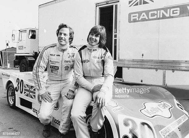 Racing drivers Davina Galica and Mark Thatcher son of British Prime Minister Margaret Thatcher sitting on the bonnet of a new car prior to competing...