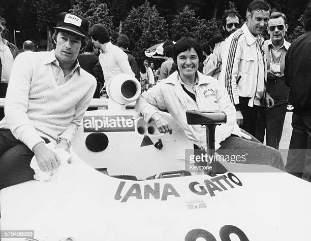 Racing drivers Lella Lombardi and Mark Thatcher son of British Prime Minister Margaret Thatcher sitting on their car prior to the '24 Hours of Le...