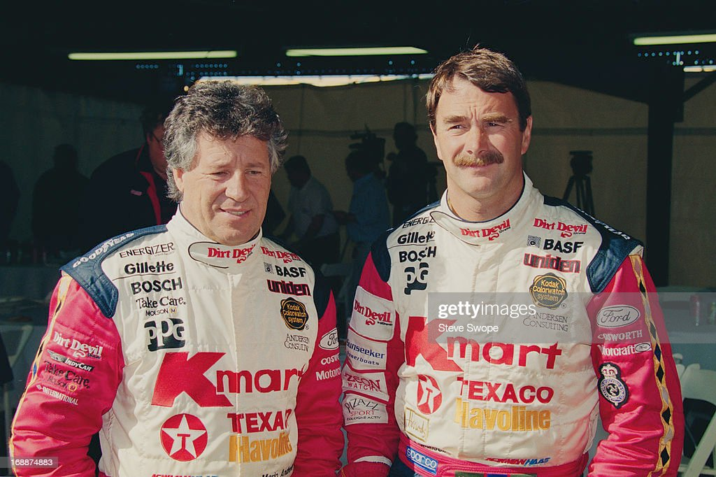 Racing drivers Mario Andretti and Nigel Mansell during testing of the new Lola T93/00 Newman Hass Indy car at Phoenix International Raceway Phoenix...