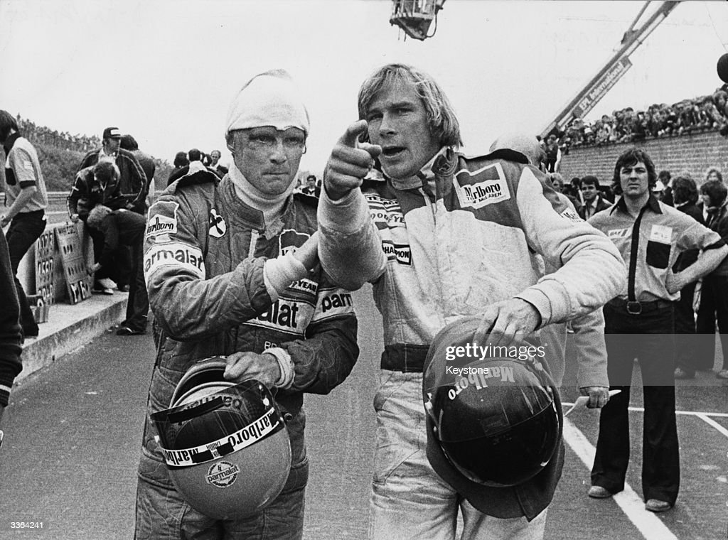 Racing drivers <a gi-track='captionPersonalityLinkClicked' href=/galleries/search?phrase=Niki+Lauda&family=editorial&specificpeople=218060 ng-click='$event.stopPropagation()'>Niki Lauda</a> (left) and James Hunt (1947 - 1993) after both were involved in a multiple collision and forced to retire at the start of the Belgian Grand Prix , Belgium, 21st May 1978.