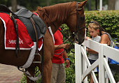 Racing fan enjoys a moment with a pony on July 23 2016 at Saratoga Race Course Saratoga Springs NY