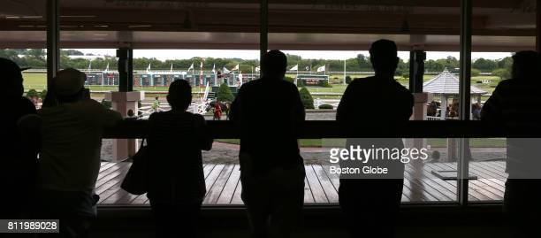 Racing fans and spectators watch from inside and outside as live horse racing takes place at Suffolk Downs in East Boston on Jul 8 2017 It was one of...
