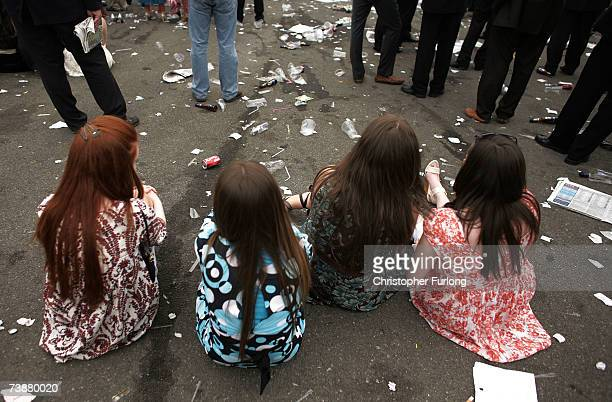 Racing fans take a break on ladies day the second day of the Grand National meeting at Aintree Racecourse on 13 April 2007 Liverpool England Friday...