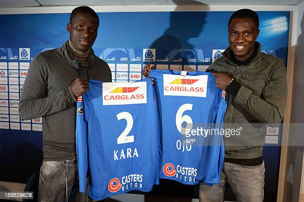 KRC Racing Genk's football team new recruits Kim Ojo from Nigeria and Kara Serigne Mbodj from Senegal present their new jersey during a press...