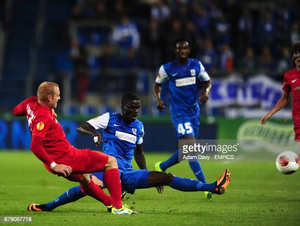 Racing Genk's Serigne Mbodji and Thun's Marco Schneuwly battle for the ball