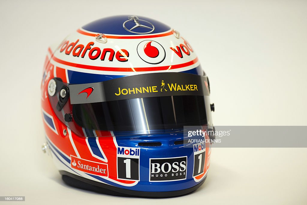 A racing helmet belonging to British F1 driver Jenson Button is pictured during a media launch for the new McLaren Mercedes MP4-28 F1 car for the 2013 season at the McLaren Technology Centre in Woking, southern England, on January 31, 2013. Mexican driver Sergio Checo Perez joins Britain's Jenson Button for the 2013 season following the departure of Britain's Lewis Hamilton.