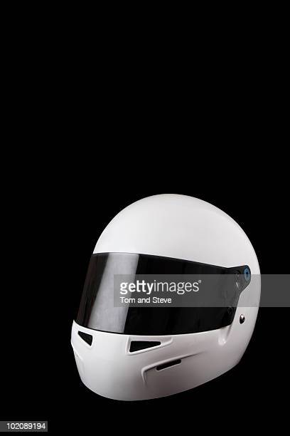 Racing helmet on black background with copy-space