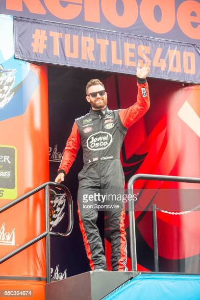 Racing Jewel Osco Toyota driver Corey LaJoie waves to the fans during the Monster Energy Cup Series Tale of the Turtles 400 driver introductions on...
