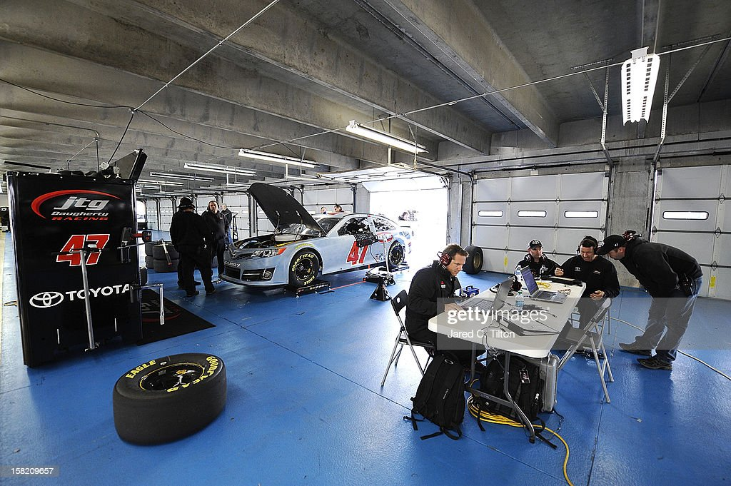 Racing members look over data during testing at Charlotte Motor Speedway on December 11, 2012 in Concord, North Carolina.
