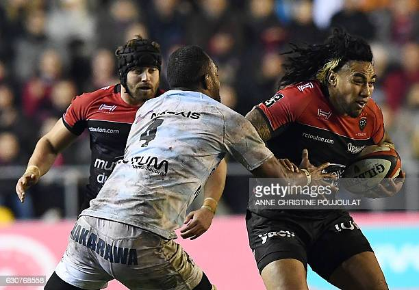 Racing Metro 92 Fijian lock Leone Nakarawa vies with RC Toulon's New Zealand centre Maa Nonu during the French Top 14 rugby union match between...