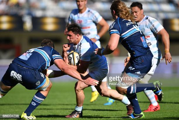 Racing Metro 92 French hooker Camille Chat vies with Montpellier's French lock Paul Willemse and Montpellier's South African flanker Jacques Du...