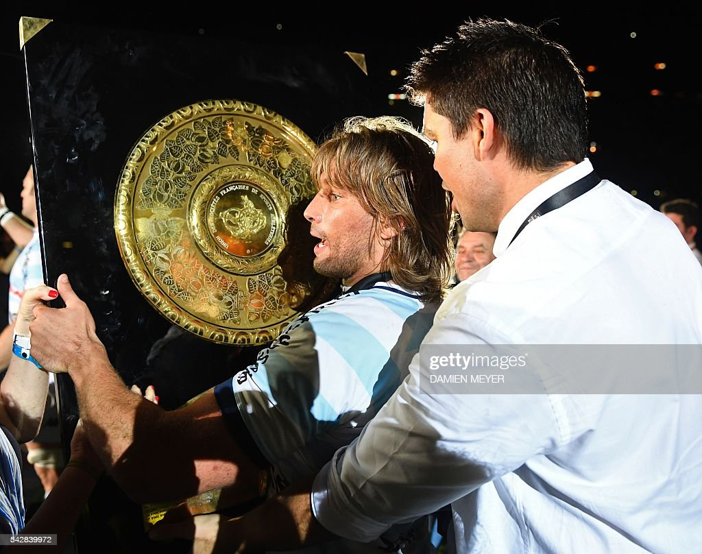 Racing Metro 92 French hooker Dimitri Szarzewski (C) celebrates with the 'Bouclier de Brennus' (Brennus Shield) after winning the French Top14 rugby union final match Toulon vs Racing 92 at the Camp Nou stadium in Barcelona on June 24, 2016. / AFP / DAMIEN