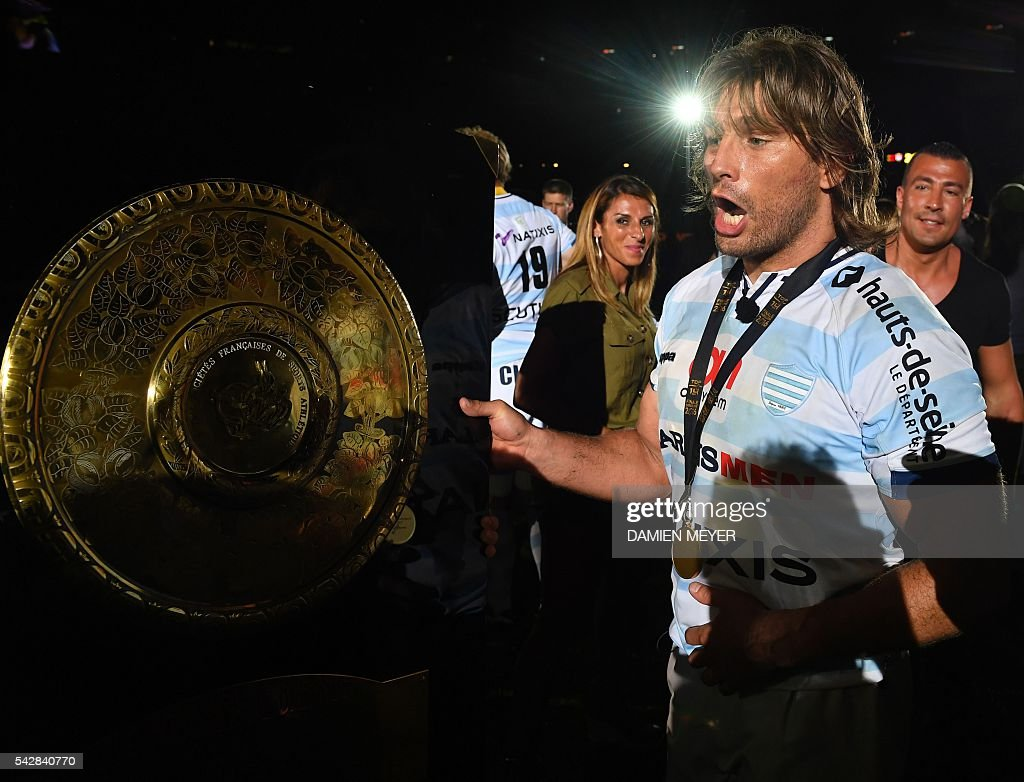 Racing Metro 92 French hooker Dimitri Szarzewski celebrates with the 'Bouclier de Brennus' (Brennus Shield) after winning the French Top14 rugby union final match Toulon vs Racing 92 at the Camp Nou stadium in Barcelona on June 24, 2016. / AFP / DAMIEN
