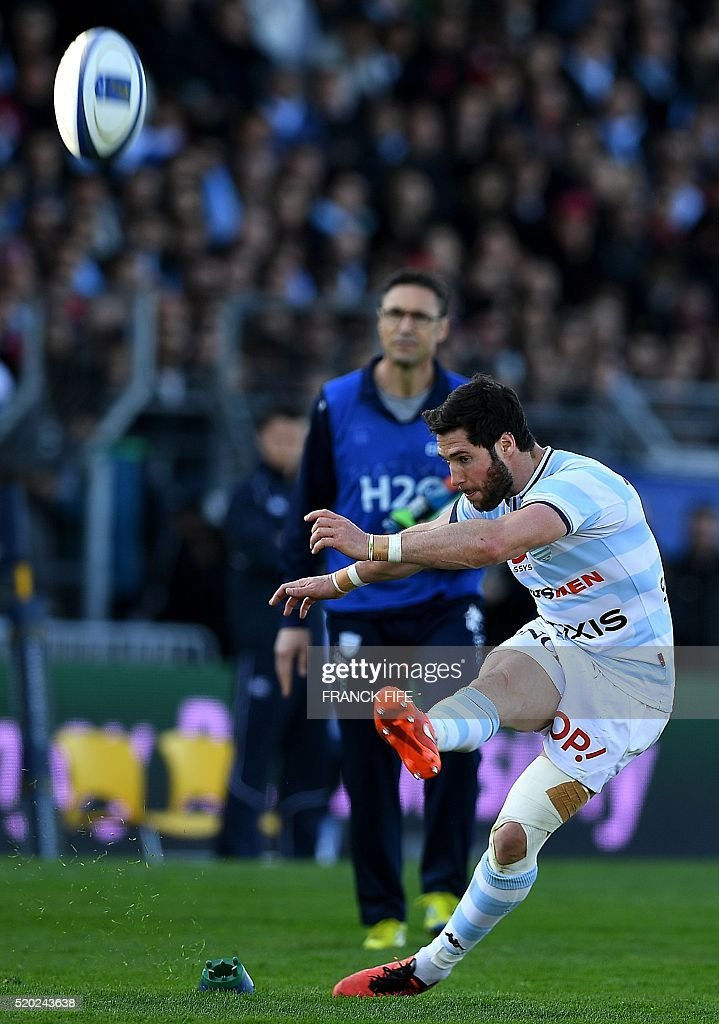 Racing Metro 92 French scrumhalf Maxime Machenaud hits a penalty kick during the European Rugby Champions Cup match between Racing Metro 92 and...