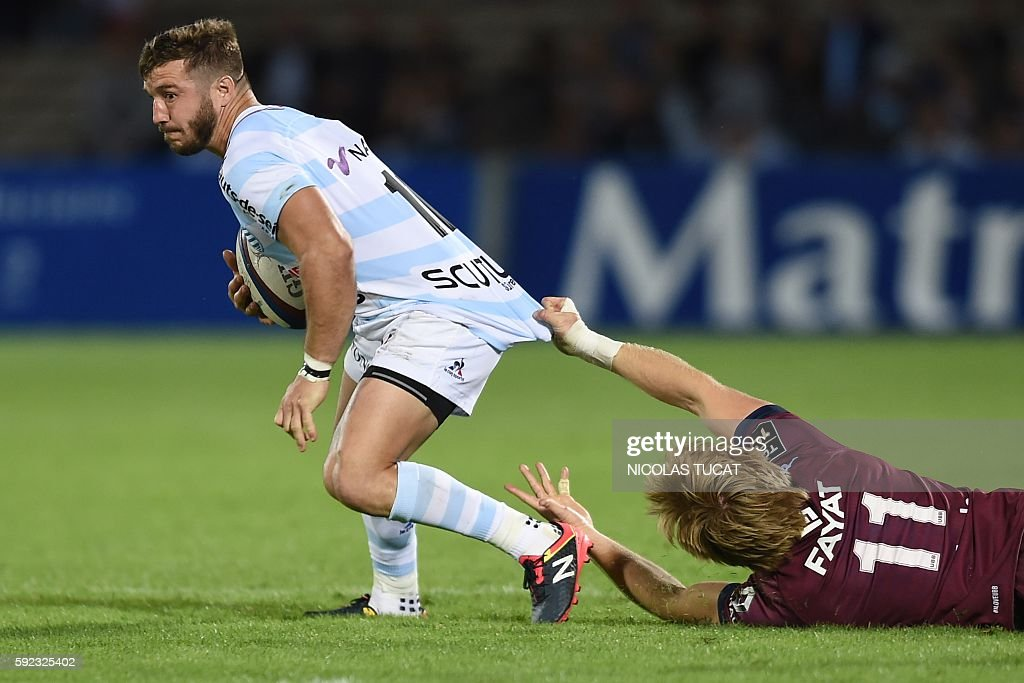 TOPSHOT Racing Metro 92 French wing Marc Andreu is tackled by BordeauxBegles' Australian wing Blair Connor during the French Top 14 rugby union match...