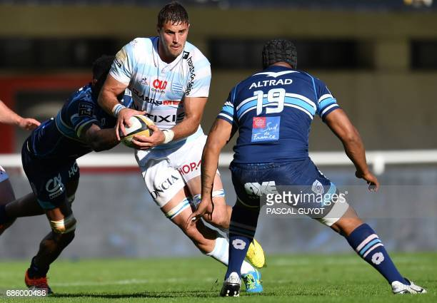 Racing Metro 92 South African lock Gerbrandt Grobler vies with Montpellier's Fijian flanker Akapusi Qera during the French Top 14 Rugby union match...