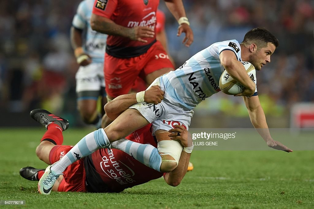 Racing Metro 92's French fullback Brice Dulin (R) is tackled by RC Toulon's South African wing Bryan Habana during the French Top14 rugby union final match Toulon vs Racing 92 at the Camp Nou stadium in Barcelona on June 24, 2016. / AFP / LLUIS