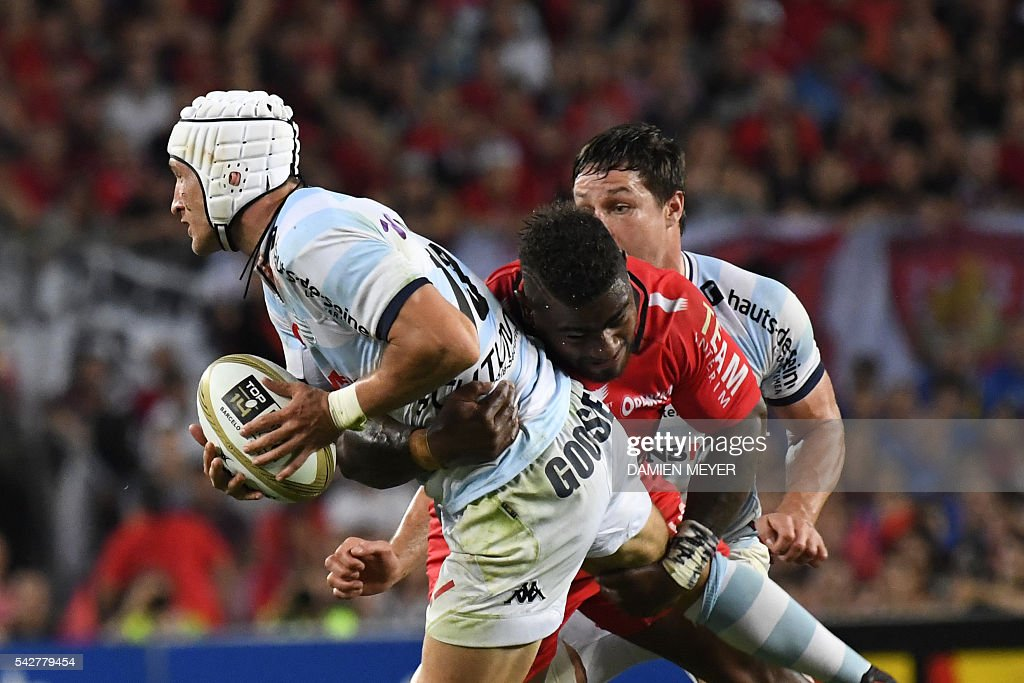 Racing Metro 92's South African fullback Johannes Goosen (L) is tackled by RC Toulon's Fijian wing Josua Tuisova during the French Top14 rugby union final match Toulon vs Racing 92 at the Camp Nou stadium in Barcelona on June 24, 2016. / AFP / DAMIEN